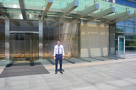 У входа в здание ТОО